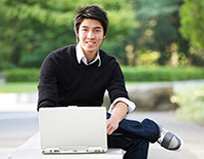 Image showing a student with laptop at the campus